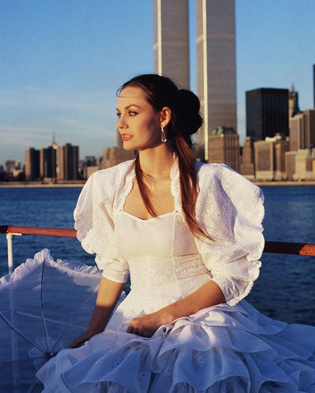 All white eyelet flounces, leg-o-mutton sleeves and a matching parasol, Crystal Gayle is a heavenly beauty while filming 'The Crystal Gayle Special' on a boat in New York harbor in front of the World Trade Centers on September 1st, 1979. 🌟🌟🌟 #crystalgayle