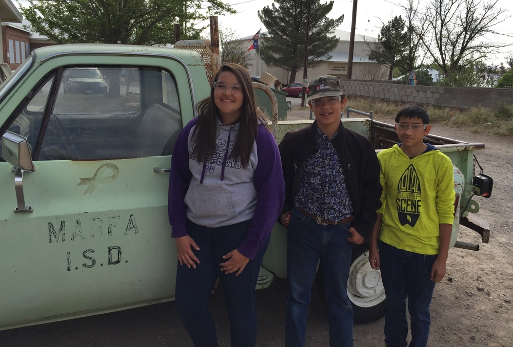 Students with the 1974 Chevrolet C10 they will work on as a project.
