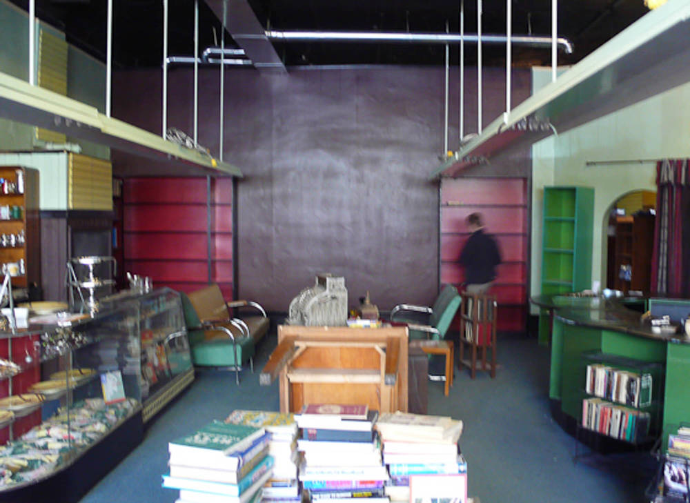Sam's Bookstore - Back wall built and painted, dressing begun...