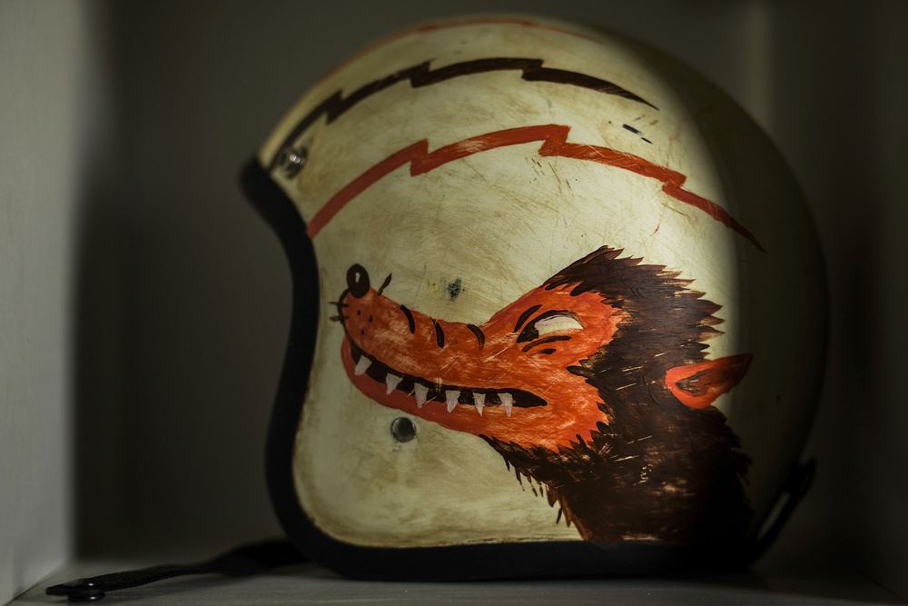 A  helmet  customized with a wild  wolf  handmade  painting  is displayed at El Solitario's workshop garage on April 30, 2015 in Galician Rias Baixas, Spain. Ex commodity trader David Borrás and his wife fashion designer Valeria Líbano founded  El Solitario Motorcycles  as a personal bet to offer their own style of conceiving motorcycles and the  fashion  market related with them. On their shop they offer all kind of handmade clothing,  accesories , leather goods and jewelry. Cast sculptors, a community trader and a musician have something in common: they have made the passion of customizing motorbikes their own business. Valtoron Sculptured Motorcycles, Café Racer Obsession and El Solitario Motorcycles are the dreams-come-true of the Delgado Brothers, Federico Ruiz and David Borrás.