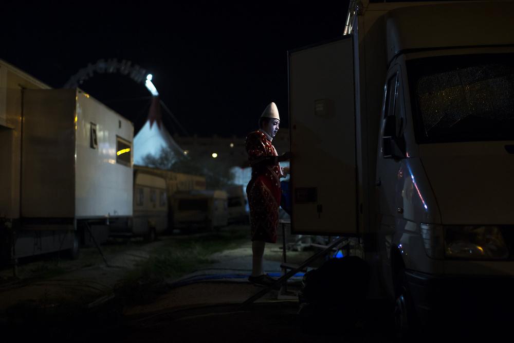 Clown Juanjo Leon enters to his caravan-truck at Gran Circo Mundial circus' backstage