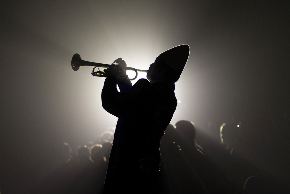 "Clown  Juanjo  Leon  performs his trumpet dressed up as "" Carablanca "" during a  performance  of  Gran Circo Mundial circus  on November 27, 2015 in Madrid, Spain. The ""Carablanca"" character (also known as "" Pierrot "") is a white face clown ornamentally dressed who acts as the boss of other clowns during a show. Juanjo (36 years-old) started performing this role on his father Pepin's group eight years ago.  Pepin Leon Trio  are both and his brother Dani.  Gran Circo Mundial  is a 40 years-old Spanish  circus  where  famil y lifes and stories have mixed together across the time. From the  trapeze  artists of the  Pyongyang National Circus  to the  Rampin  family descendants,  clown s,  magician s or aerial  permormer s share the  stage  and part of their private lifes. Their show was running inMadrid in Autumn 2015."