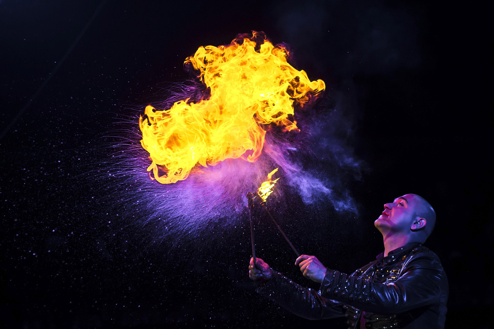 "Illusionist  Israel Santos ""spits""  fire  from his mouth during a Flash Back  Magic  Show performance at  Gran Circo Mundial circus  on November 29, 2015 in Madrid, Spain. Israel, second cousin of Dani Rivelino, comes from the Santos Family artistically known as the  Rampins : an ancient family of circus  artists  with more than 300 years of history.  Gran Circo Mundial  is a 40 years-old Spanish  circus  where  famil y lifes and stories have mixed together across the time. From the  trapeze  artists of the  Pyongyang National Circus  to the  Rampin  family descendants,  clown s,  magician s or aerial  permormer s share the  stage  and part of their private lifes. Their show was running inMadrid in Autumn 2015."