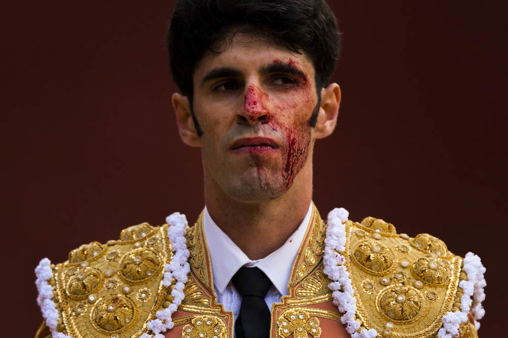 "Bullfighter  Alejandro  Talavante  reacts with his face covered by a bull's  blood  after killing a horned from El Pilar Breeder during San Isidro fair at "" Las Ventas ""  bullring  on May 29, 2014 in Madrid, Spain."