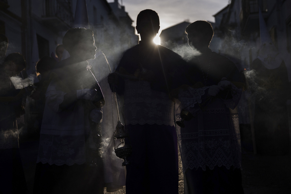 "Smoke  of burning  incense  carried by  altar   boys  flows during the  Holy Week procession  of ""Nuestro Padre Jesus Nazareno"" on April 2, 2015 in the  Andalucian  town of  Arriate , Spain"