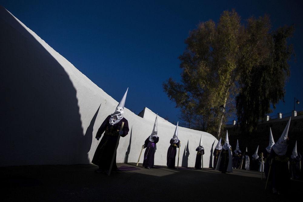 "Penitents  dressed as "" Nazarenes "" take part in the  Holy Week procession  of ""Nuestro Padre Jesus Nazareno"" on April 2, 2015 in the  Andalucian  town of  Arriate , Spain"