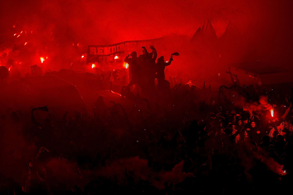 Real Madrid  fans set alight  flares  cheering their team at their arrival to  Santiago Bernmabeu  Stadium before the Copa del Rey Round of 16 second leg match between Real Madrid CF and Club Atletico de Madrid on January 15, 2015 in Madrid, Spain.