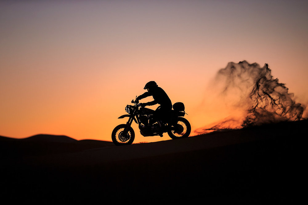 Motorcycle  craftsman  Mauro Abadini  rides on the  dunes  a  Harley Davidson  customisation made by  El Solitario MC  and  Classic Co  Garage during the shooting of a documentary movie on November 25, 2016 in  Merzouga ,  Morocco .