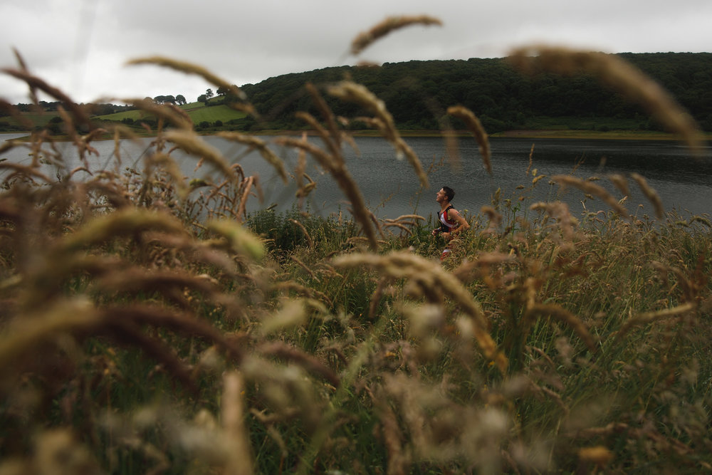 An athlete competes during the running course of the Ironman 70.3 UK Exmoor at Wimbleball Lake on June 25, 2017 in Somerset, United Kingdom.