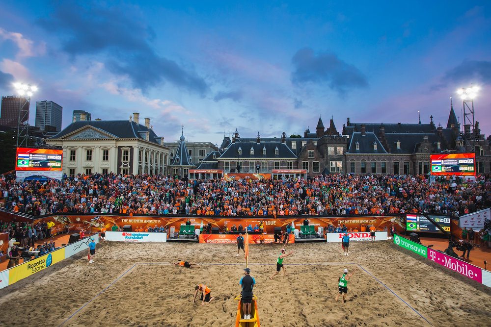 Bruno Oscar Schmidt (R) from Brazil celebrates winning the match point with his teammate Alison Cerutti as Christiaan Varenhorst (2ndL) from The Netherlands and his teammate Reinder Nummerdor (L) lies on the sand during the FIVB Beach Volleyball World Championships Male Final Match between The Netherlands and Brazil at the main course on July 5, 2015 in The Hague, Netherlands.