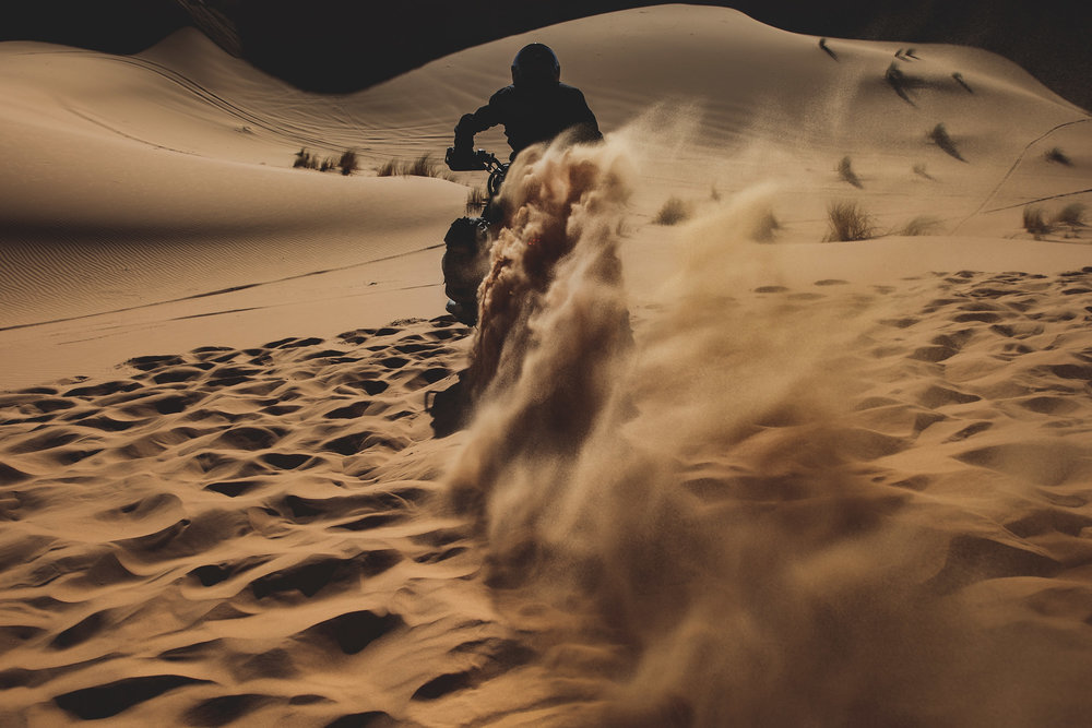 An offered rider  speeds up on the  dunes  his  Harley Davidson  customisation made by  El Solitario MC  and  Classic Co  Garage during the shooting of a documentary movie on November 25, 2016 in  Merzouga ,  Morocco .
