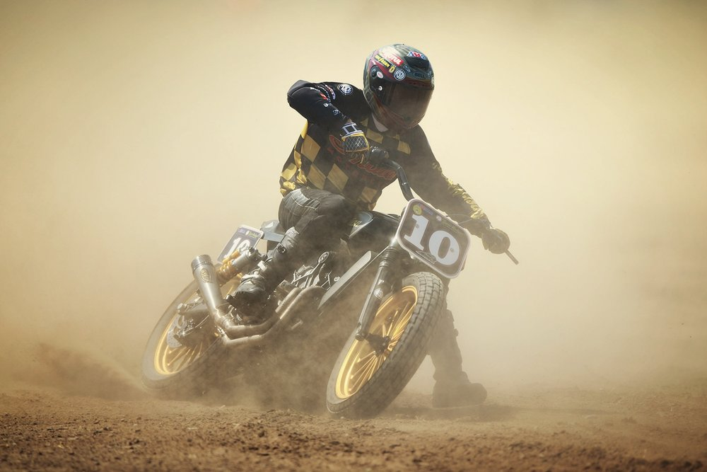 American  motorcycle  racer and designer of custom motorcycles  Roland Sands  skids with his  Indian  bike as he competes during one of the qualifying rounds of  EL ROLLO Flat Track Race  at Lasarte-Oria Hippodrome on June 8, 2016 in Lasarte-Oria, at Guipuzcoa province, Spain. A flat track is a motorcycle race where participants compete around an oval track with dirt or loosely packed surface. El ROLLO Flat Track Race is held annually as part of the  Wheels & Waves  urban culture festival which takes place between the cities of Donostia-San Sebastian and  Biarritz.