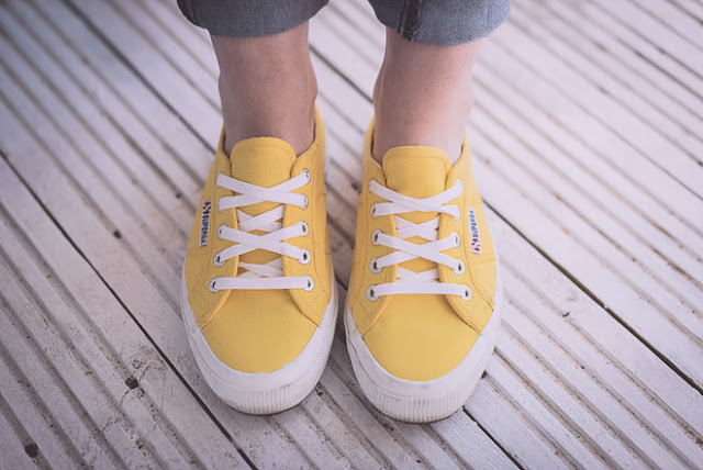 yellow trainers to jazz up jeans and a t-shirt