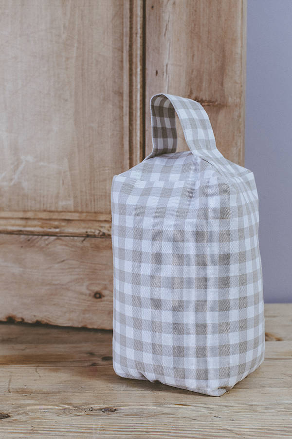 THIS GINGHAM DOORSTOP IS THE PERFECT CHOICE FOR A KITCHEN DOOR OR BACK DOOR.
