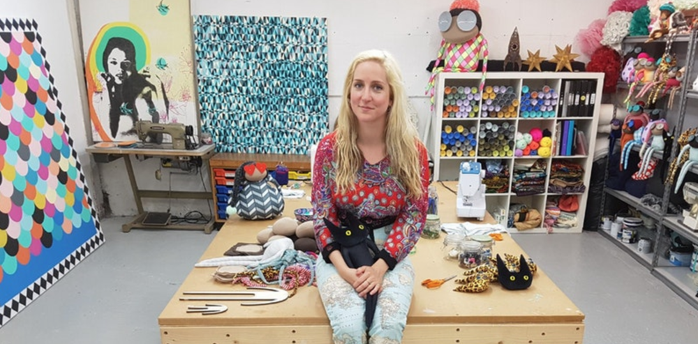 JENNY IN HER BURST-OF-COLOUR STUDIO IN BRIGHTON