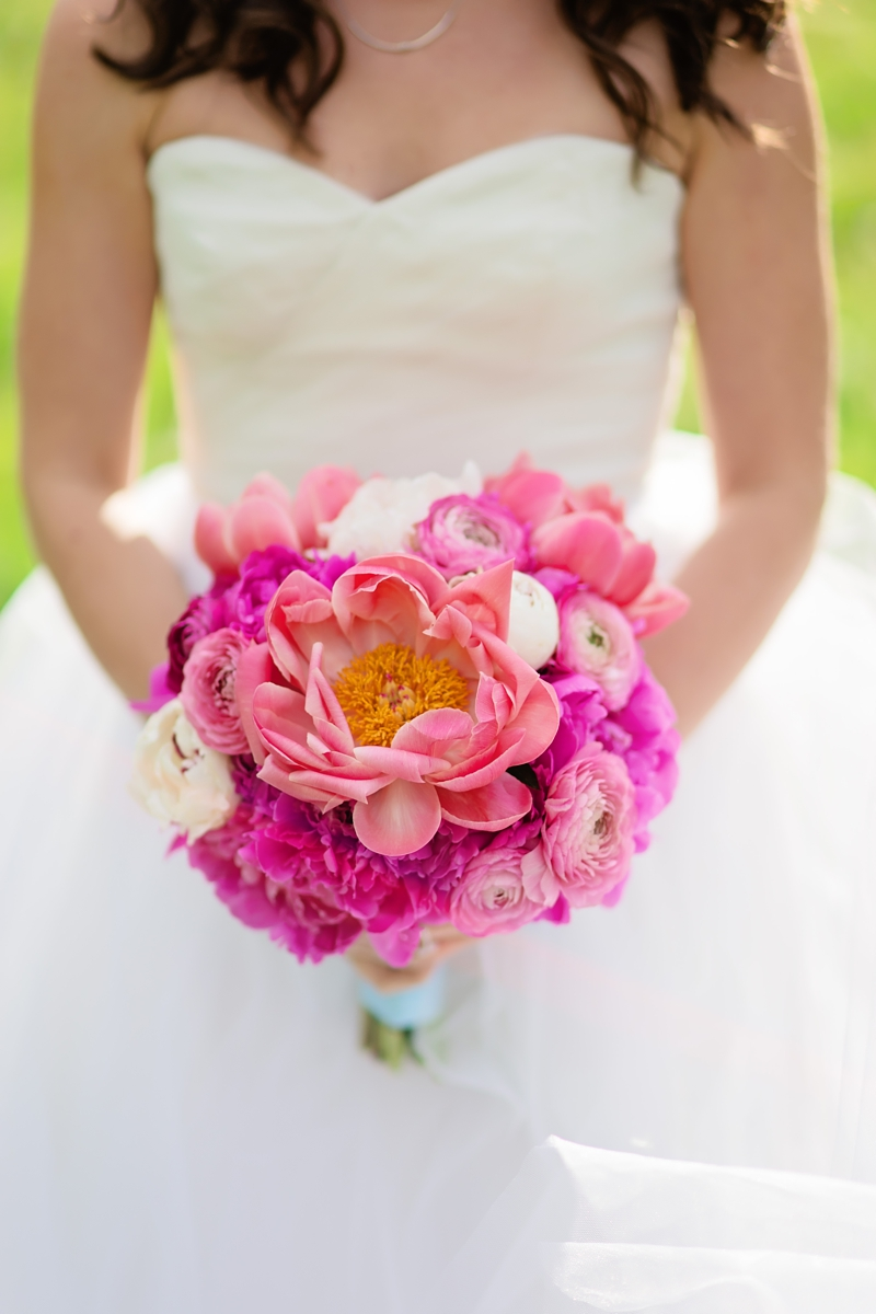 White-and-pink-summer-wedding-bouquet-made-with-peonies-ranuculus-and-carnations