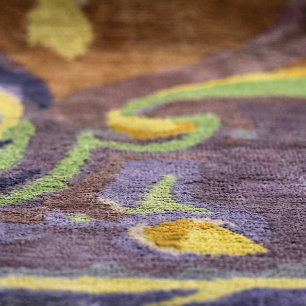 Unique and alluring, the Cavalier adds a luxe touch to your surroundings. This versatile area rug works wonderfully in the bedroom, dining area, in your study or anywhere you require accent carpeting that is breathtaking as it is functional.   This hand-knotted 100% Tibetan silk rug features a design woven directly from an original Joe Ginsberg watercolor.