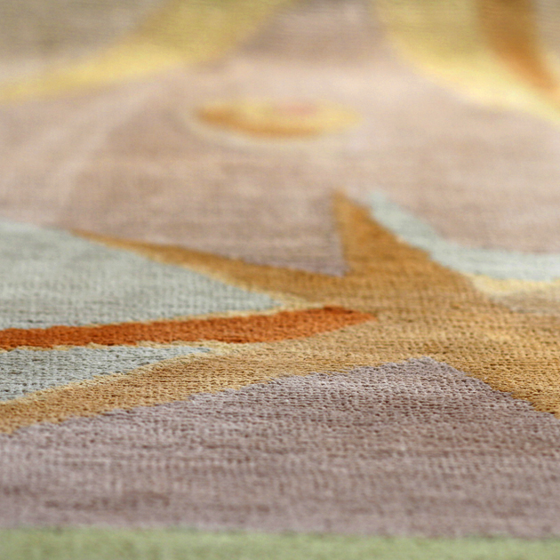 A celestial symphony, captured in luxurious silk. The Stellar area rug imparts a lighthearted, colorful touch to any room in your home.   This hand-knotted 100% Tibetan silk rug features a design woven directly from an original Joe Ginsberg watercolor.