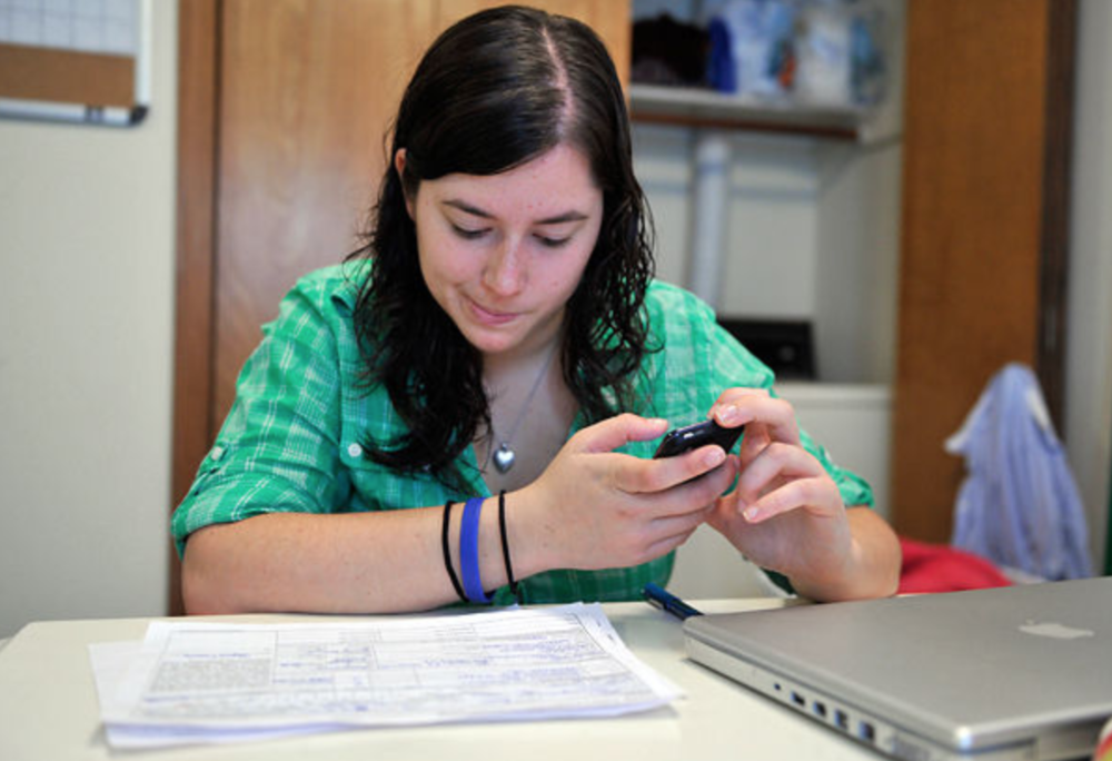 An MU junior majoring in elementary education Alyssa Essers, 20, fills out employment applications in hopes to find a job that will help her to get by through another year of school. PHOTO BY VALERIE MOSLEY / COLUMBIA MISSOURIAN