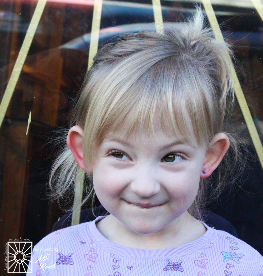 This little cutie was so much fun, and definitely one of our best clients in the last while! Mic pierced her earlobes, not a peep or a flinch, and she picked out some beautiful 3mm synthetic Purple Opals from NeoMetal. Such a great choice for a great little visitor!