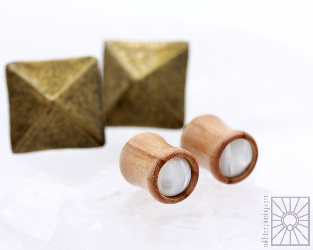 Beautiful hand-carved wood plugs from Omerica Organic!  Olive wood with Mother of Pearl inlay.