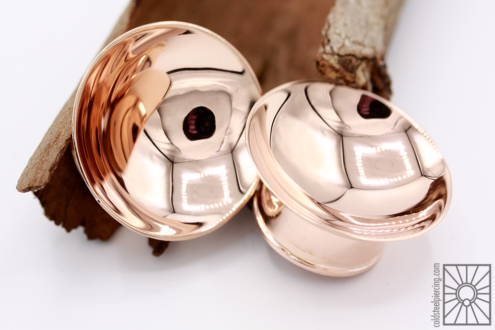 "These 1"" plated rose gold ""Singing Bowl"" plugs from Tawapa are so amazingly shiny (and so hard to photograph)!"