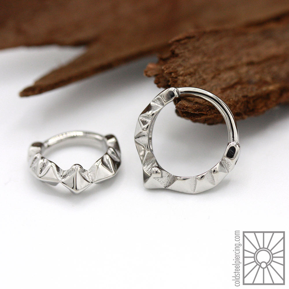"We are really loving the incorporation of geometric lines and shapes in the ""Pavilion"" steel hinged ring from Tether Jewelry, great for those who want something a little more eye catching!"