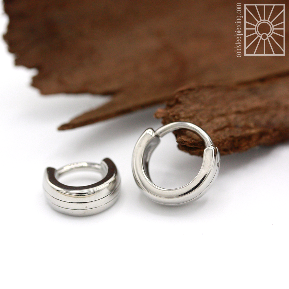 "Simple and bold, the ""Rift"" hinged ring from Tether Jewelry."
