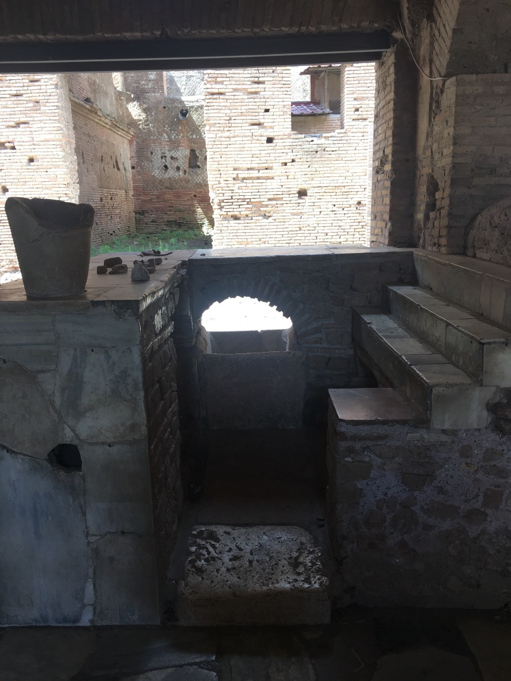 Here's the side shot of the bar, you can see the sink (!!!) and shelves where they displayed their wares. Again. This is from the FIRST CENTURY.