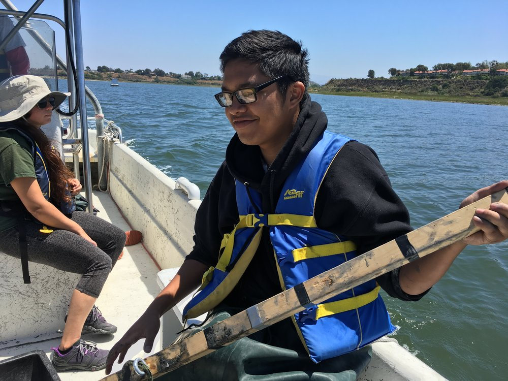 T. Nguyen on the boat after collecting cores.