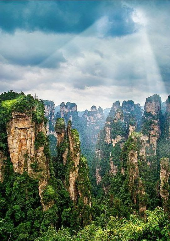 Pandora… Okay well at least the   Tianzi Mountain Nature Reserve   is the next best thing. The reserve is in Wulingyuan, China and is famous for it's stone towers that disappear into the thick clouds.