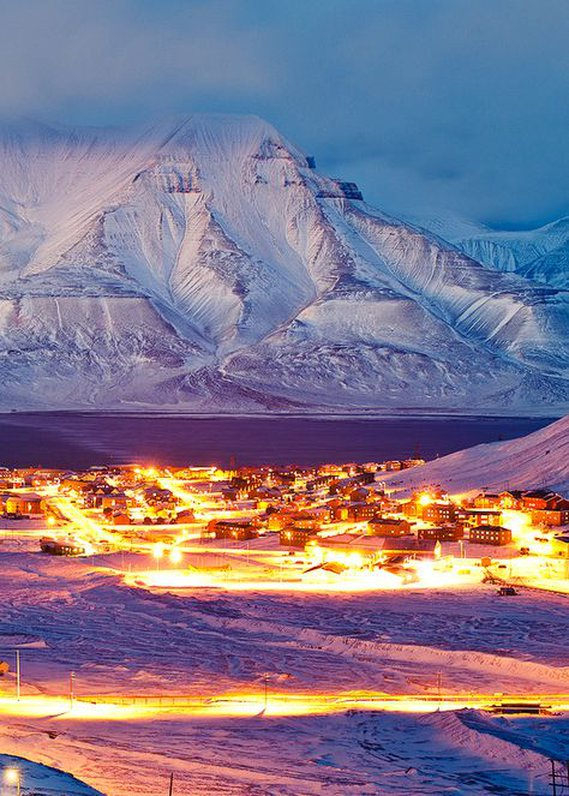 The North Pole! Well.. kinda…   Svalbard   is a archipelago (group of islands) between Norwa  y and The North Pole. The surrounding villages are primarily fishing and whaling villages and have recently become popular tourist   destinations.