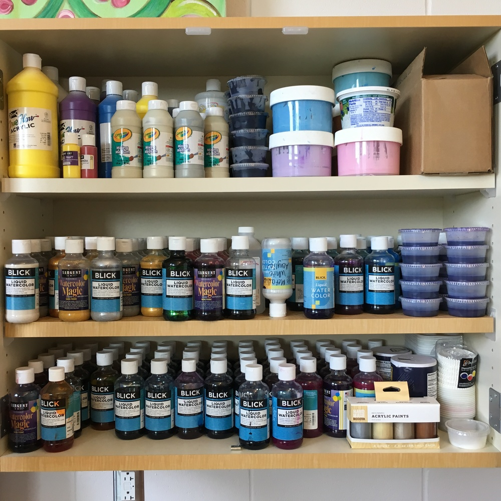 I keep all of the liquid water colors paints and specialty paints together so I can find them quickly.