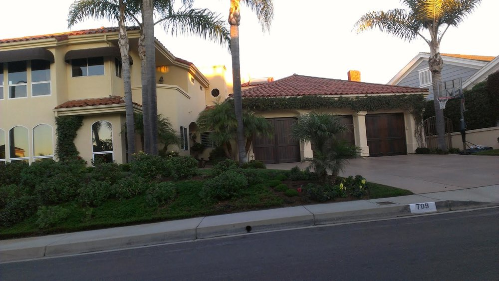 "The house on Calle Monserrat in San Clemente. Two cats in the yard. Life used to be so hard. White leather furniture inspired by the home of Marcellus Wallace in  Pulp Fiction . 65"" big-screen TV on which I watched the North Hollywood bank robbery go down live. A very nice house, especially when you're looking at it 20 years later,on the verge of homelessness. Photo: Ben Marcus."