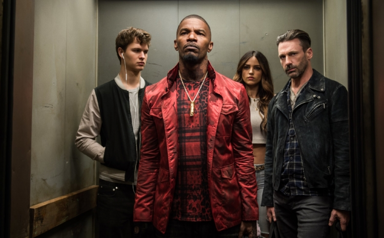 Ansel Elgort, Jamie Foxx, Elza Gonzalez and Jon Hamm enjoy a post-heist elevator ride in  Baby Driver.