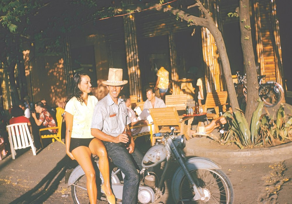 Dick Metz and a Tahitian belle scooting around the Society Islands in 1958.