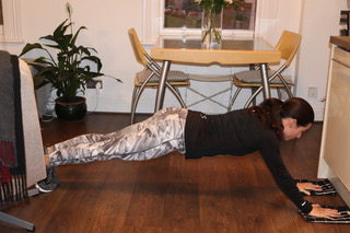 Plank (sliding hands forwards)