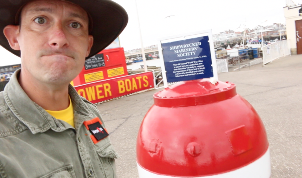 Bridlington harbour with a WW2 mine that has been turned into a charity box.