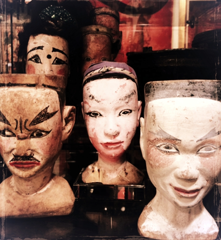 Wood puppet heads, China, circa 1900.