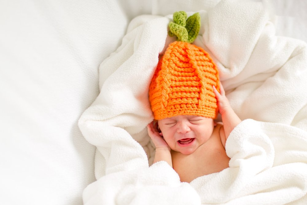 Cal wasn't the biggest fan of the pumpkin hat! Poor guy, he looked so cute in it!