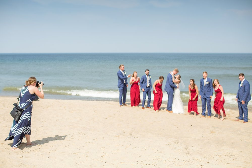 Right before the wave crashed right behind the bridal party. Good job grabbing your bride, Jack!!