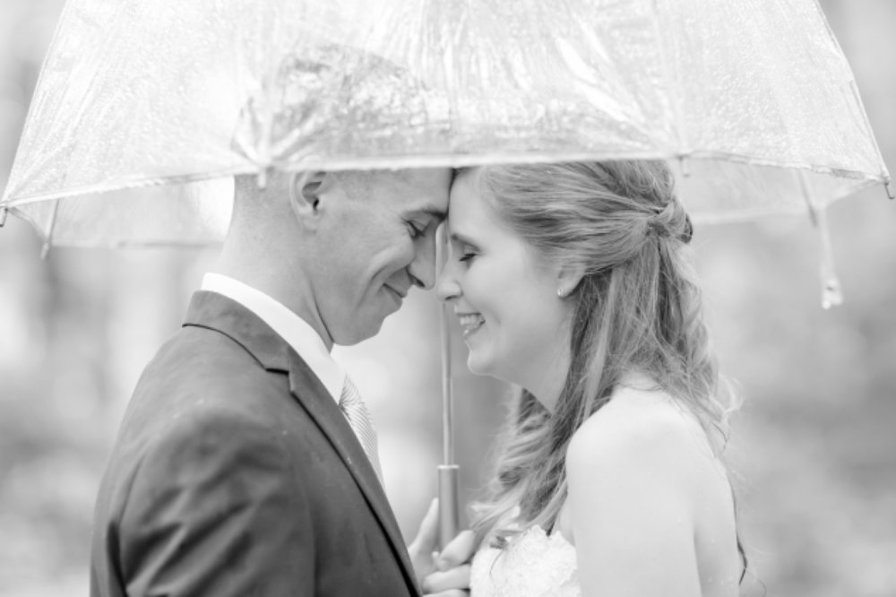 Rainy day wedding portraits can be so romantic!