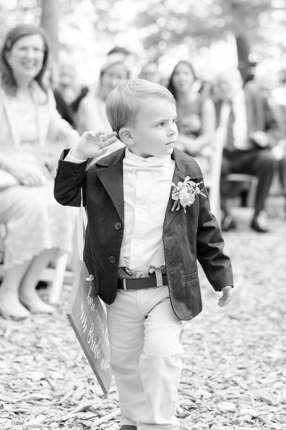 He didn't quite hold the sign right, but he still looked adorable walking down the aisle!