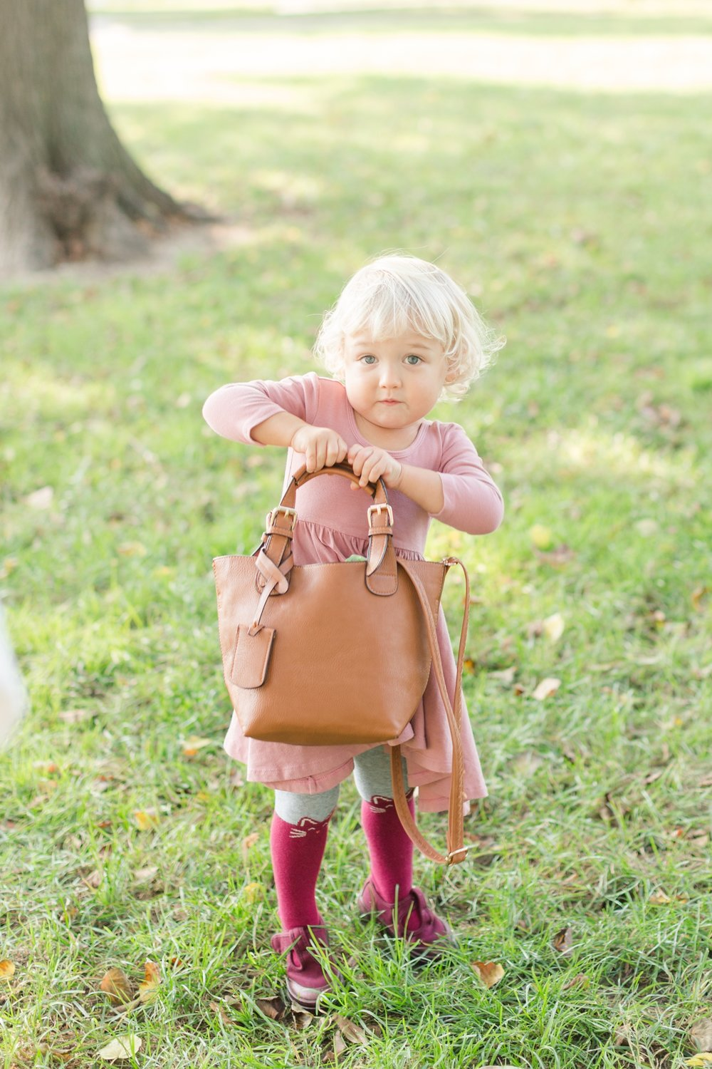 "B wanted to carry her moms purse and then she said, ""Mom it's really heavy."" Haha!"