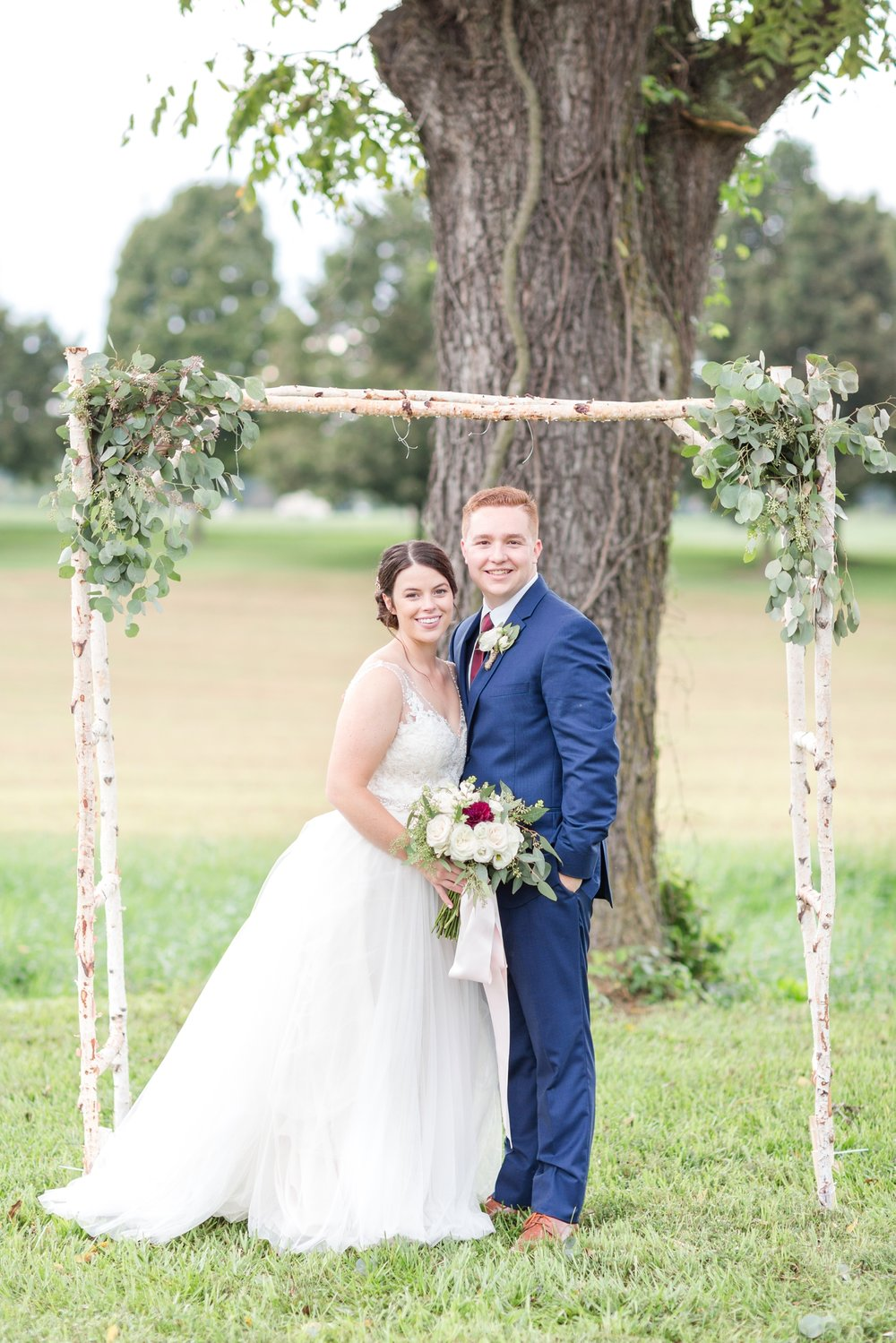This was the arch Mark and Shelby were planning on getting married under until it rained and they had to move the ceremony inside. We had to get some pictures under it because it was so cute!