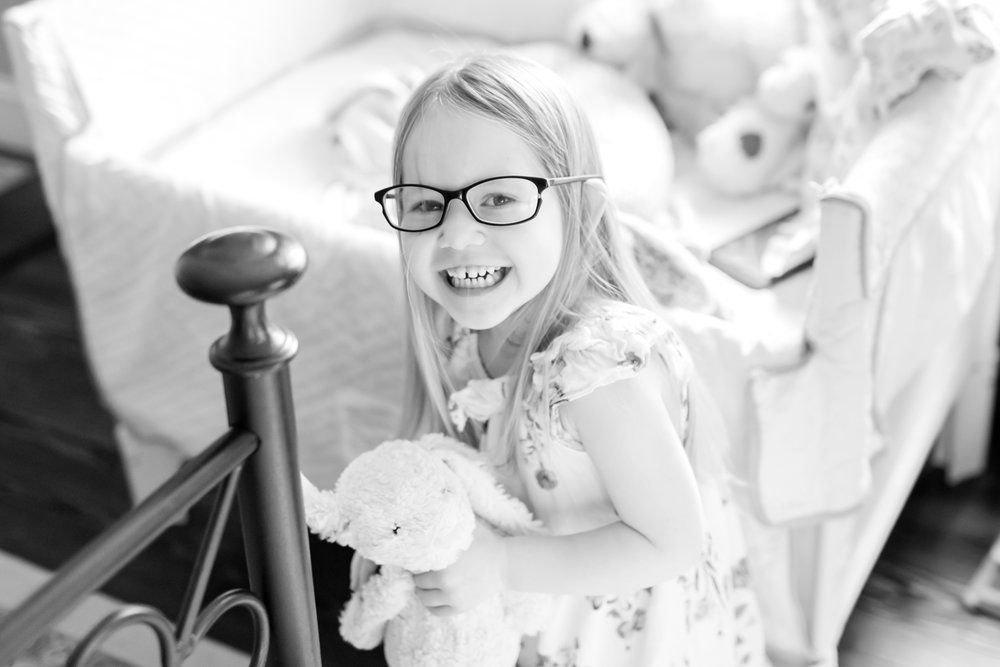 Evelyn thought it would be funny to try on mommy's glasses!