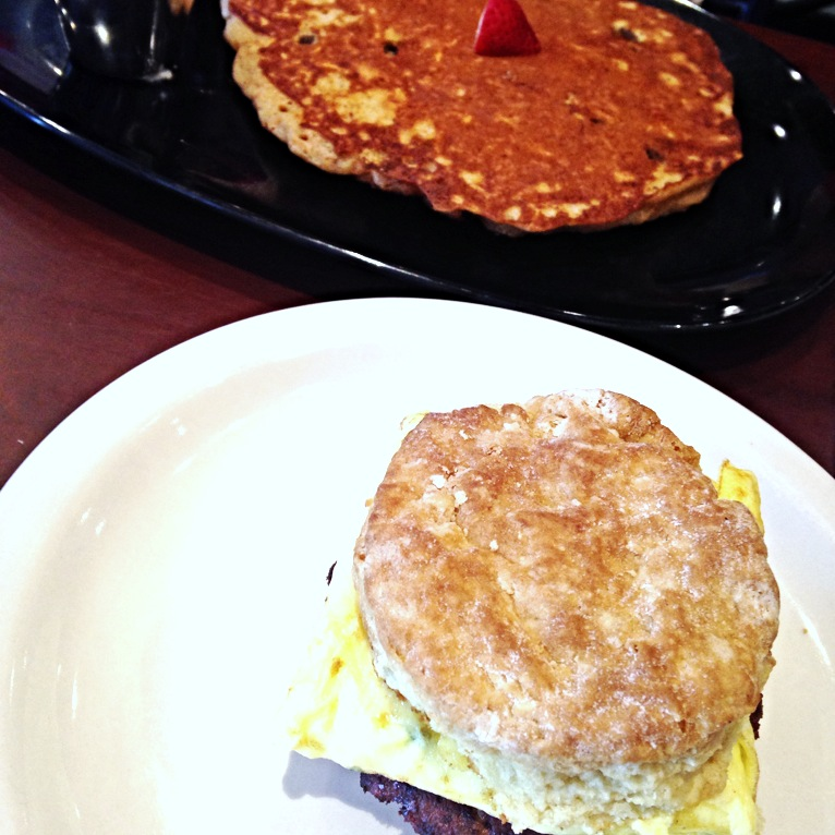 A whole wheat biscuit with egg and turkey sausage along with a carrot pancake that was SO good.