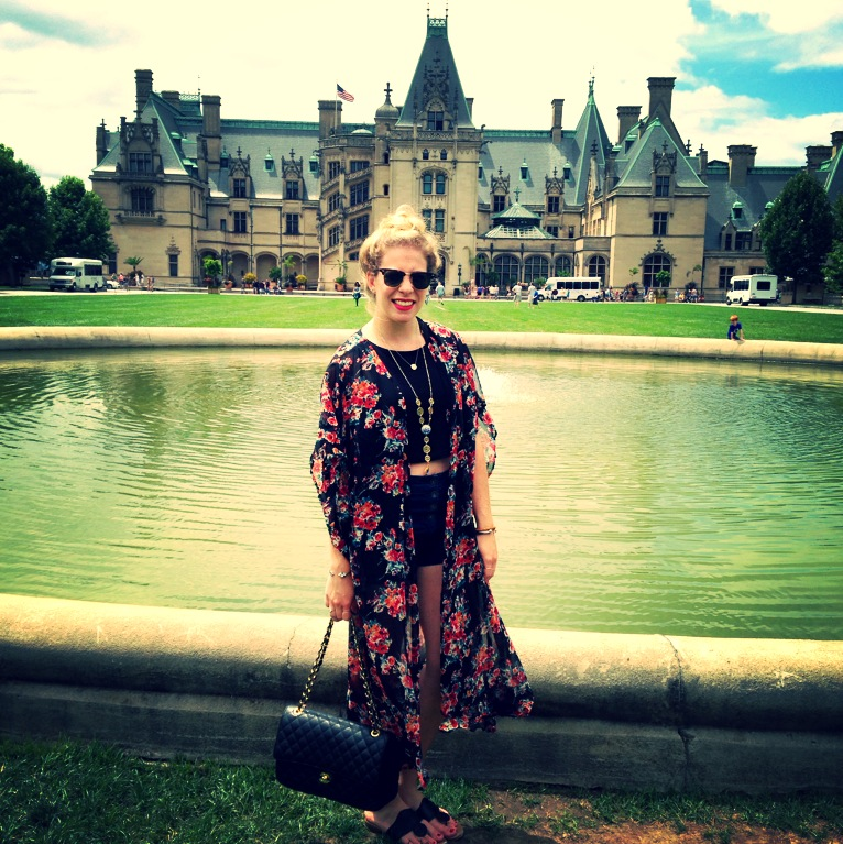 In front of the Biltmore house wearing high-waisted denim, a black crop, and a long kimono. Also wearing one of my favorite pieces from my jewelry line JoLeigh Designs.