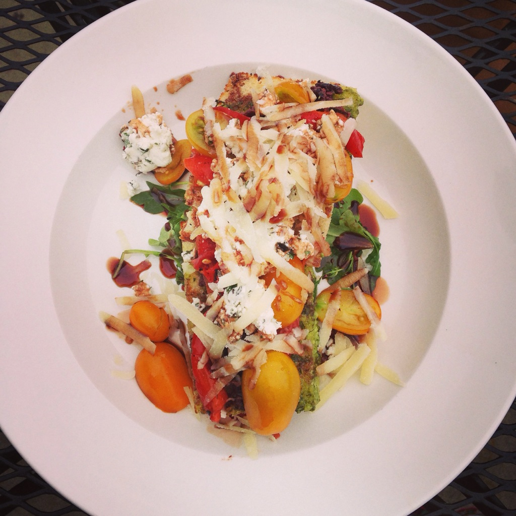 "Plate #1 - Simple Brushetta: ""Farm 44"" wild greens, goat cheese, tomato, olives, pesto."