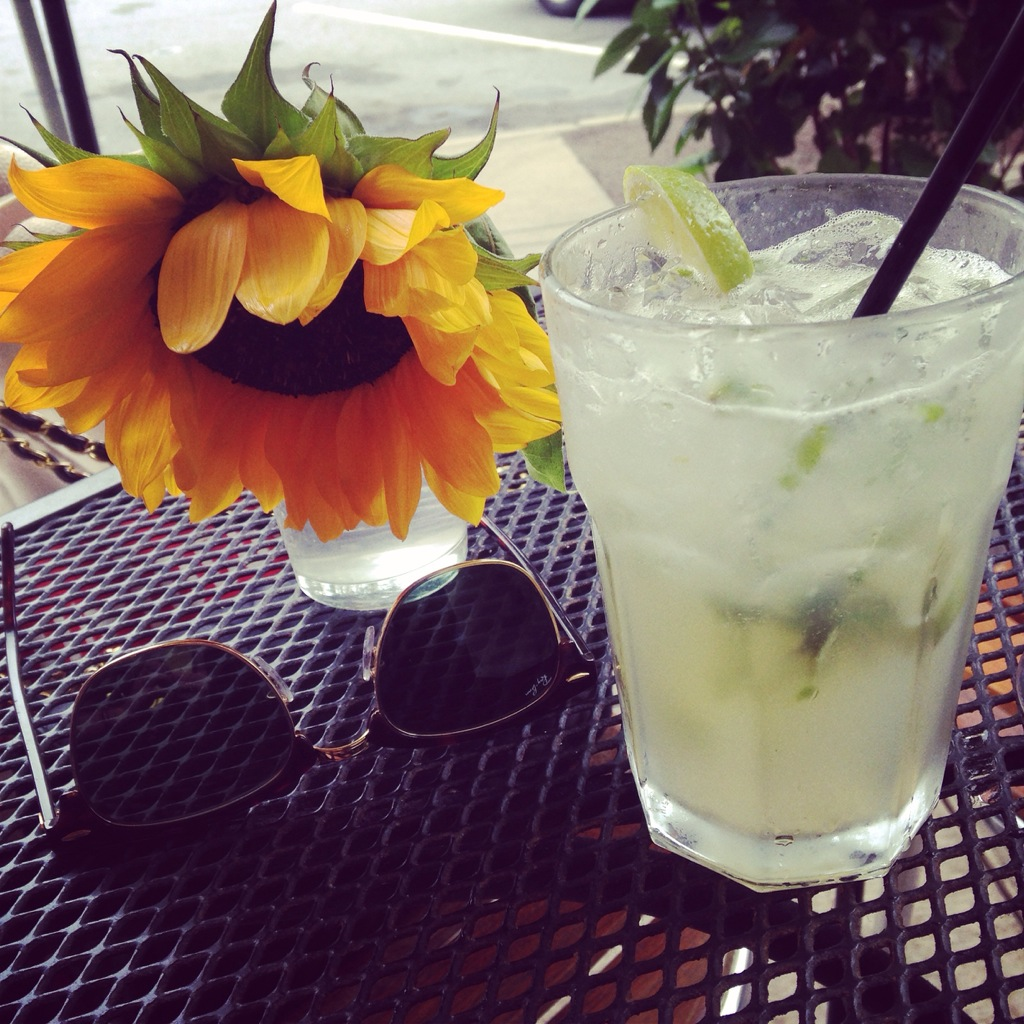 A mojito and a cheerful sunflower on our table al fresco - which is the original reason I picked this place to eat!